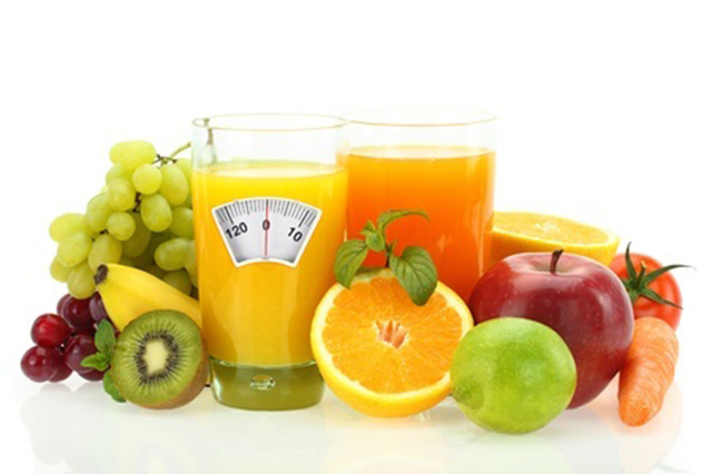 Image showing fruits and fruit drinks with face of scales on  the front of the glass of an orange drink.