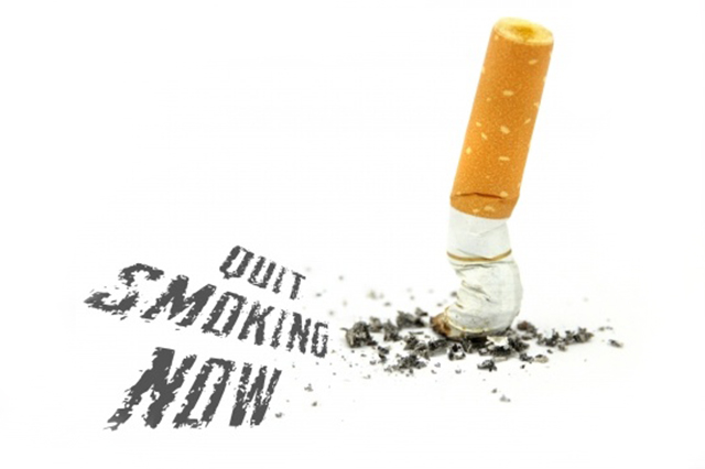 Image of stubbed cigarette and the workds Quit Smoking Now